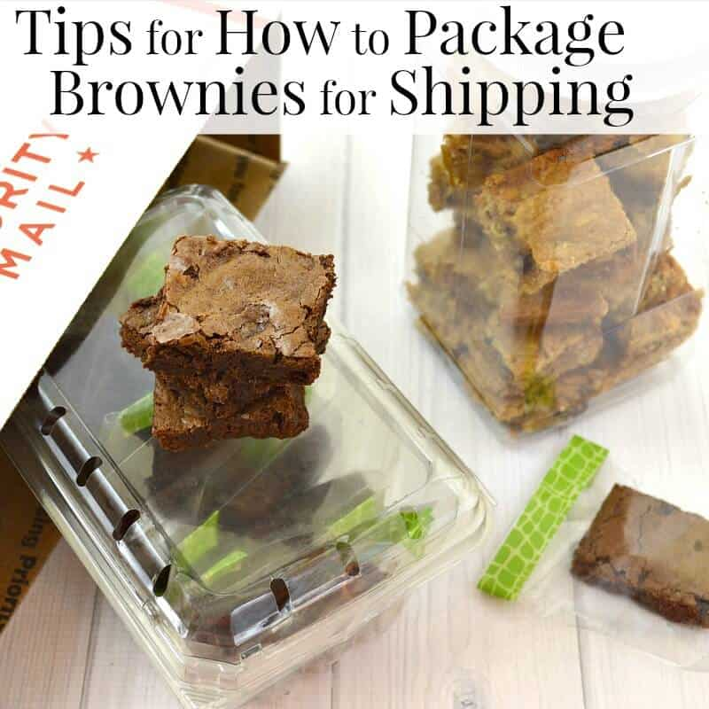 brownies in decorated clear bags and clear containers next to shipping box