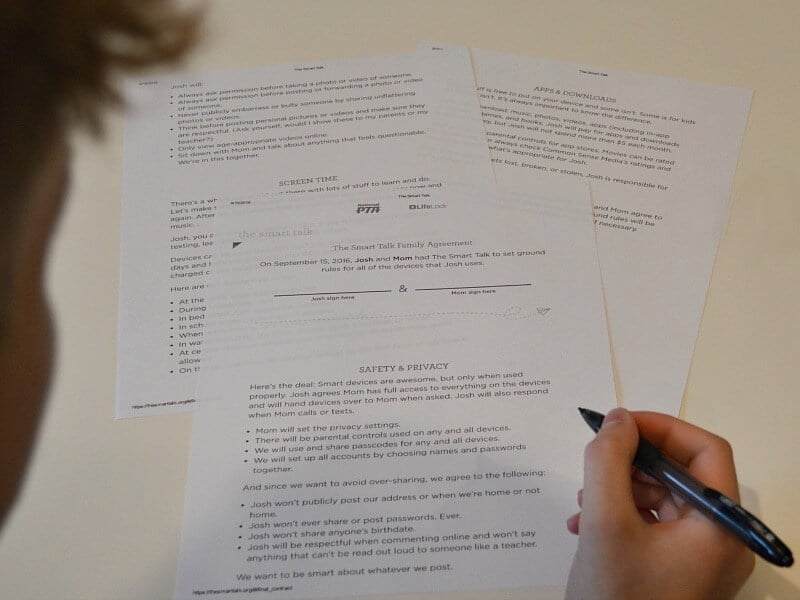 child working on worksheets with pencil