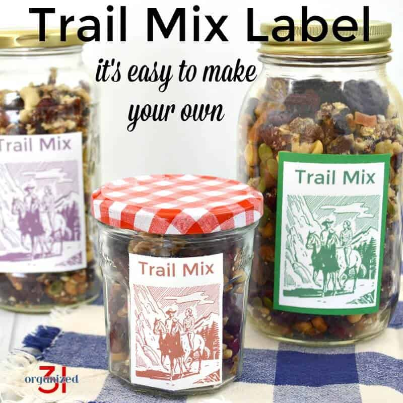 3 glass jars with trail mix and diy food labels.