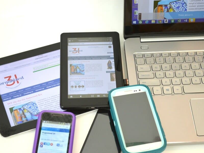 pile of cell phones, tablets and laptop