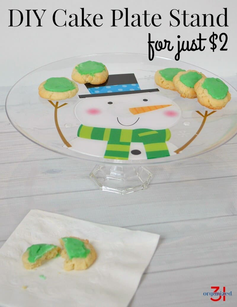 Make a DIY Cake Plate Stand for just $2 and one trip to the nearest dollar store. This Cake Plate Stand is perfect for Christmas and holiday entertaining.