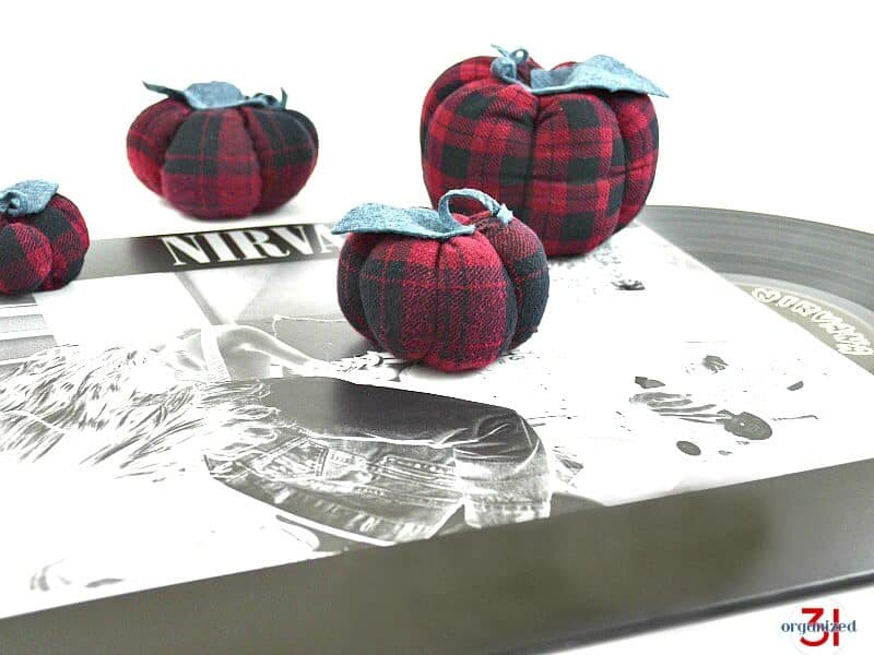 A fabric pumpkin tutorial anyone can do using an upcycled grunge shirt for a cool fall décor vibe.