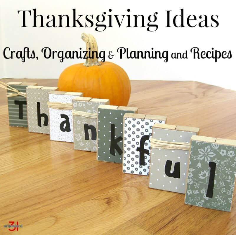 "blocks spelling ""thankful"" and pumpkin on wood table"
