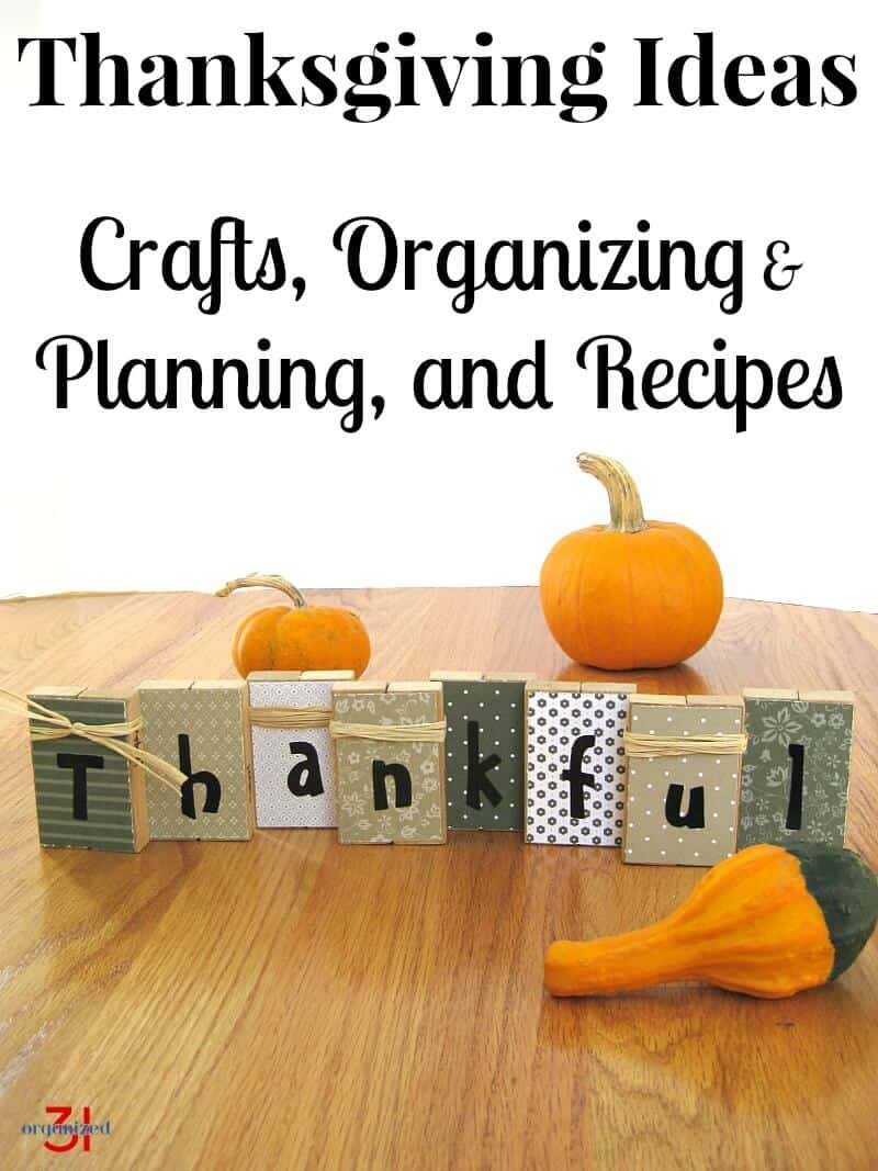 "blocks spelling ""thankful"" with small pumpkins and gourds on wood table"