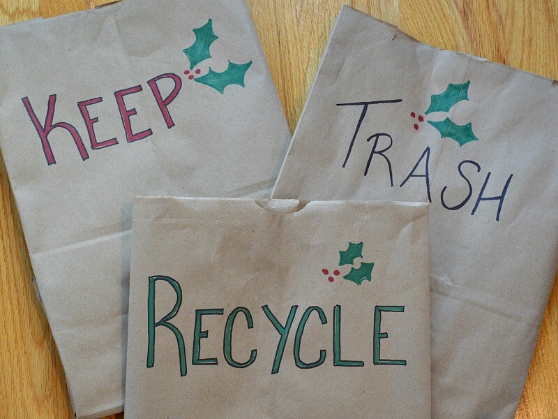 "3 brown paper bags labeled ""keep"", ""trash"" and ""recycle"""