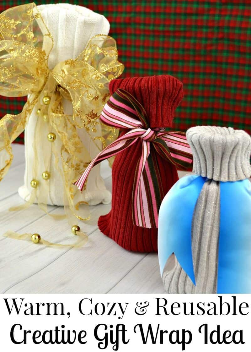 3 sweater knit  gift bags with big bows on white table