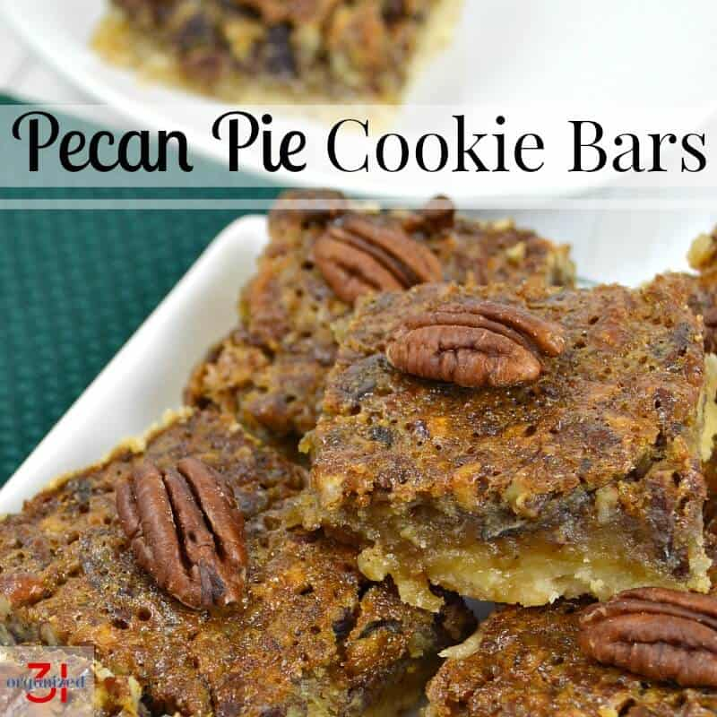 white plate of dessert bars with pecans on top of each one
