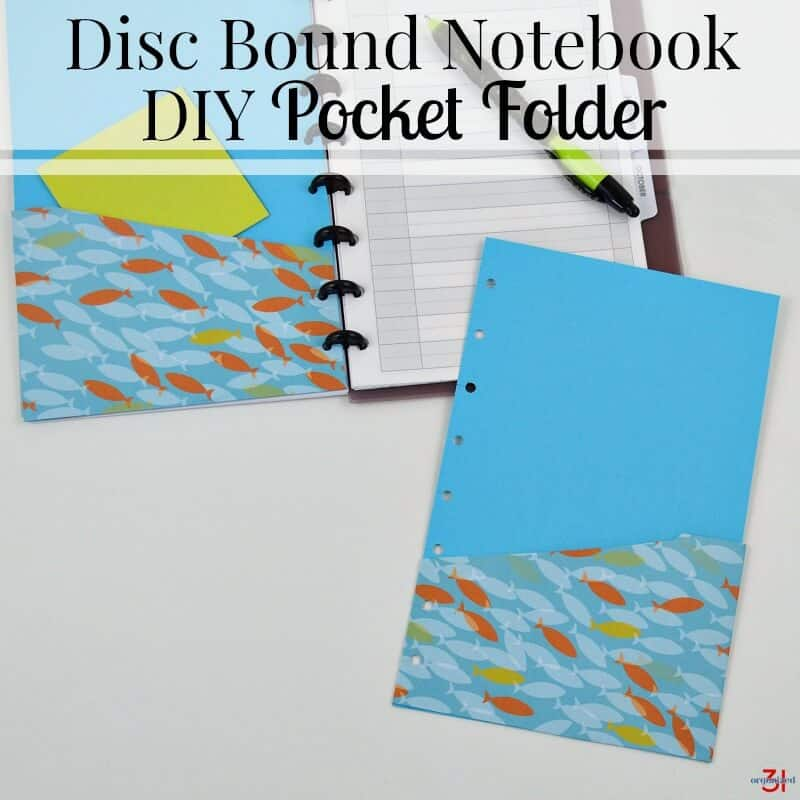 pocket folder with blue background and fish paper with planner in background