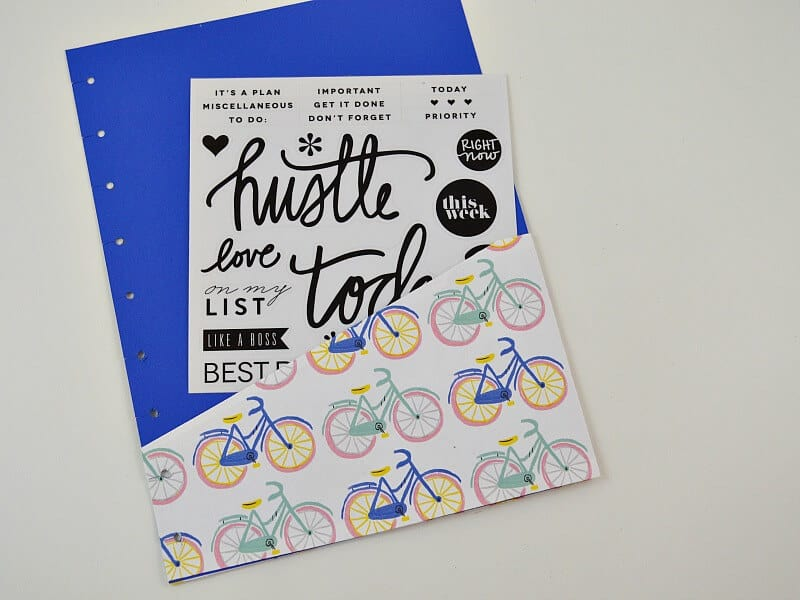 blue and white bicycle printed paper pocket holding black and white stickers