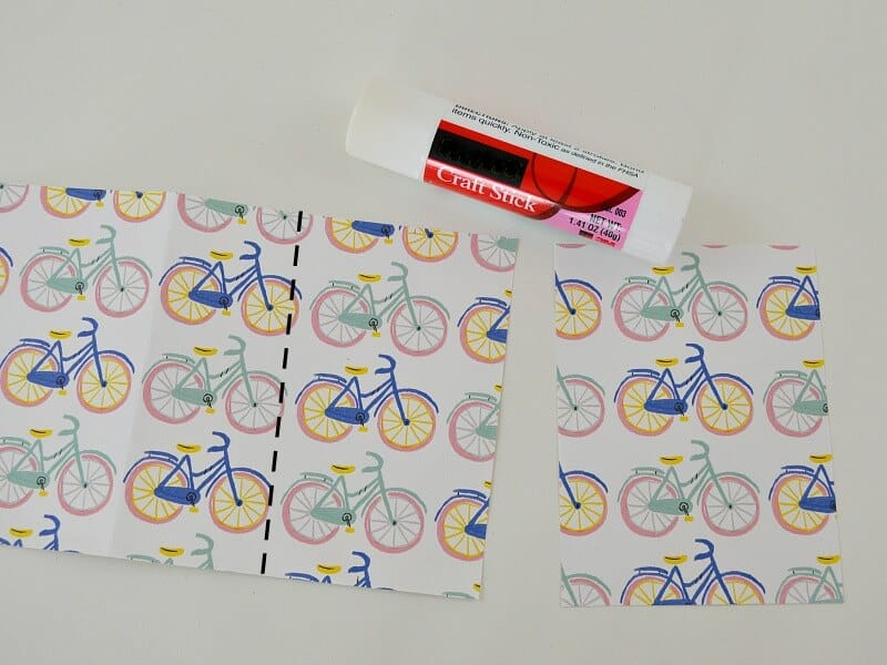 decorative paper with pastel bicycles and glue stick