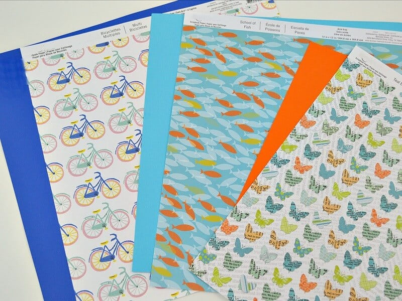 pile of brightly colored patterned craft paper
