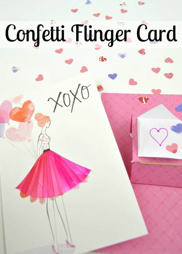pink card with pink and purple hearts scattered on table next to card of woman with pink skirt