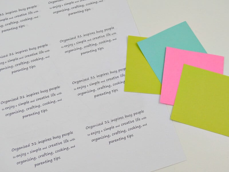 printed sheet with quote repeated in grid pattern and several colorful sticky notes to the side