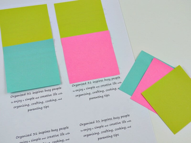 colorful sticky notes placed on top of the quotes printed on piece of paper