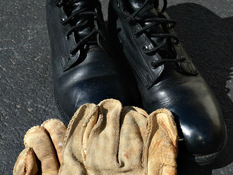 black military boots, tan leather work gloves