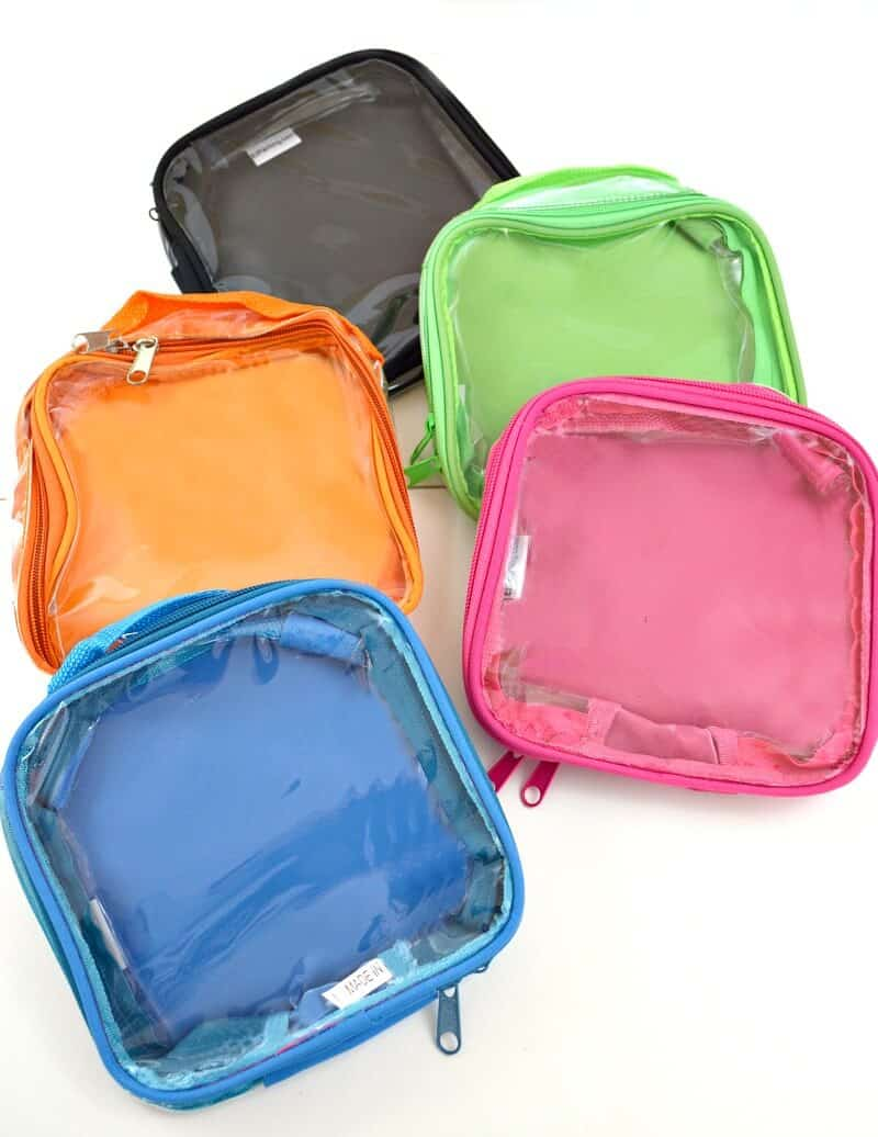 5 brightly colored packing cubes on white table