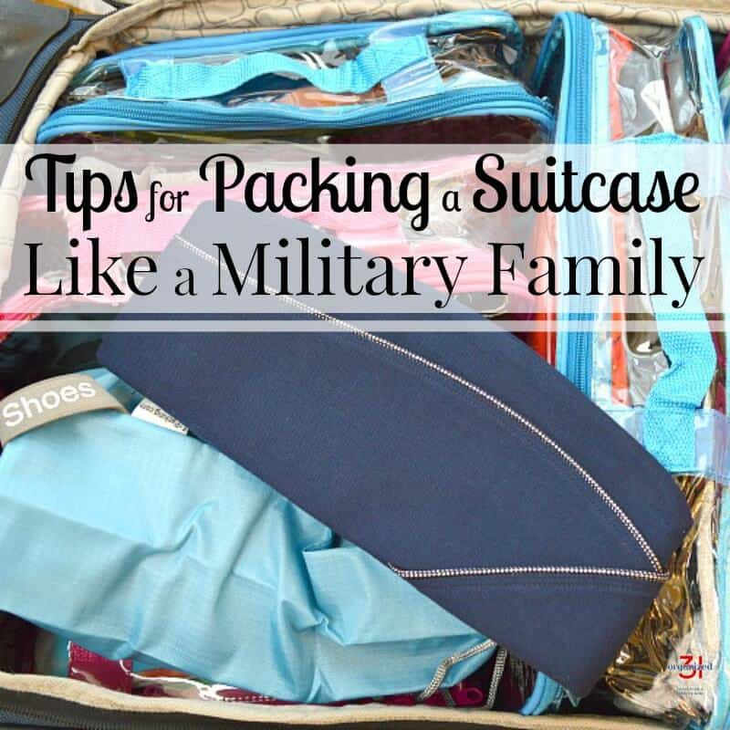 open packed suitcase with blue military flight cap on top