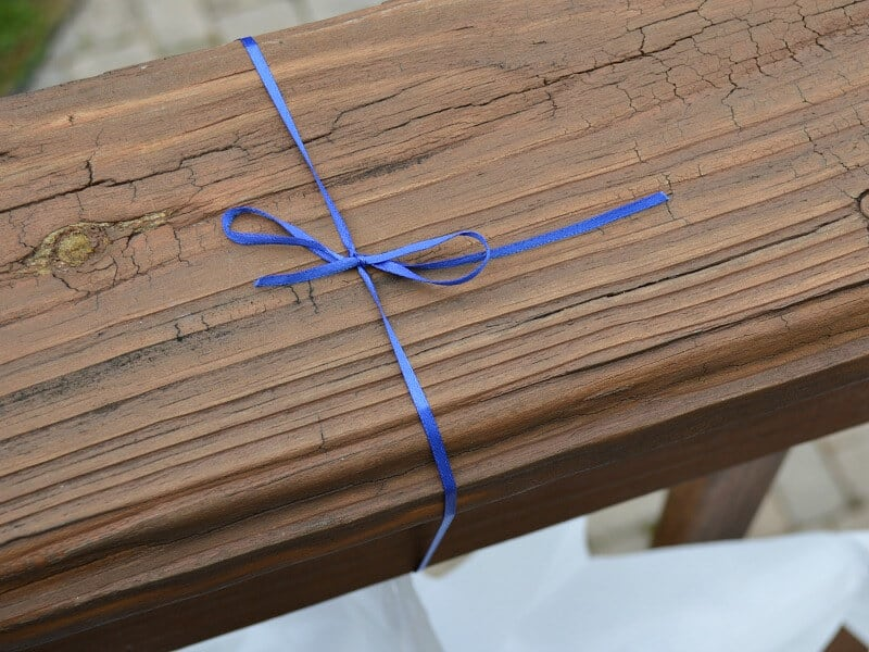 overhead view of blue ribbon tied to railing