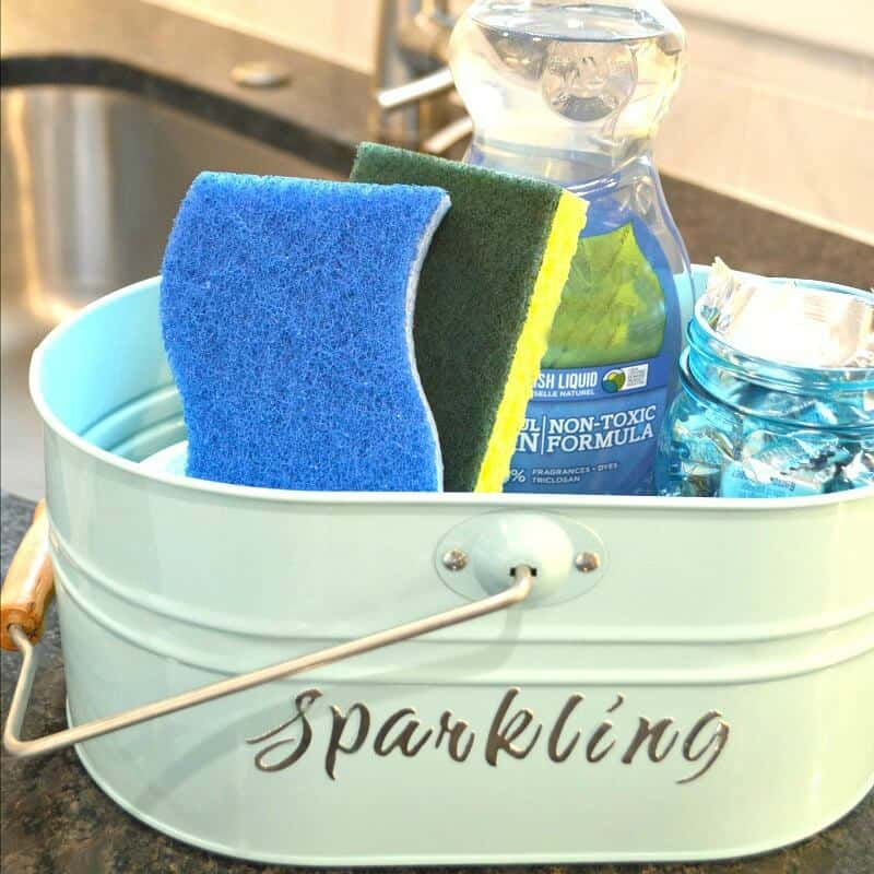 cleaning supplies organized in metal basket