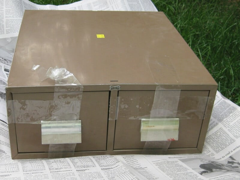 brown industrial library card drawers covered with tape and a sticker
