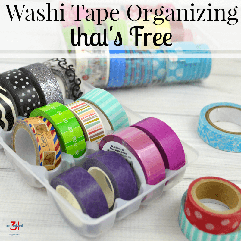 colorful rolls of washi tape organized in tray on white wood table