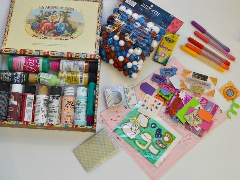 pile of different craft supplies on table