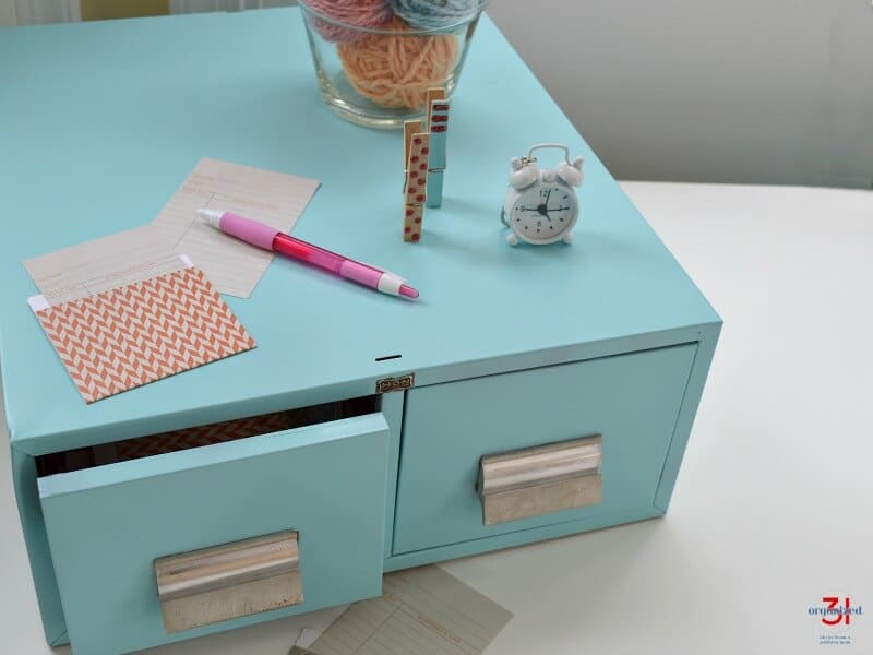 light blue library card drawers styled with library card pockets and accessories