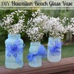 image of three blue glass flower vases made of jars with white flowers and text overlay