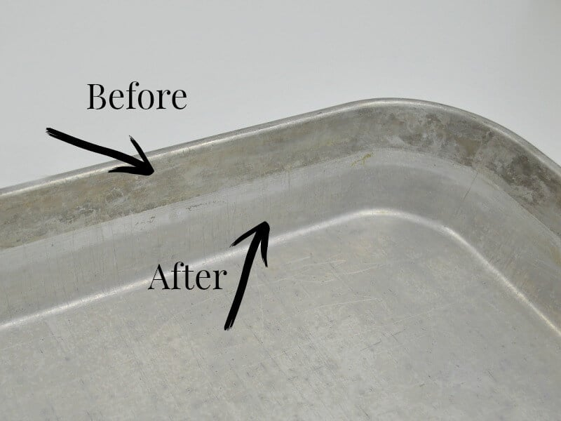 aluminum pan with stain near top of pan and arrows pointing to the before stained part and the after clean part