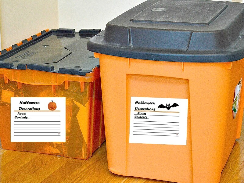orange and black storage tubs with Halloween-themed organizing labels on the front