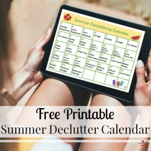 summer decluttering calendar on tablet with text overlay