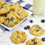 blueberry oatmeal cookies with blueberries and glass of milk
