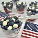 red white and blue fruit dessert cups with American flags