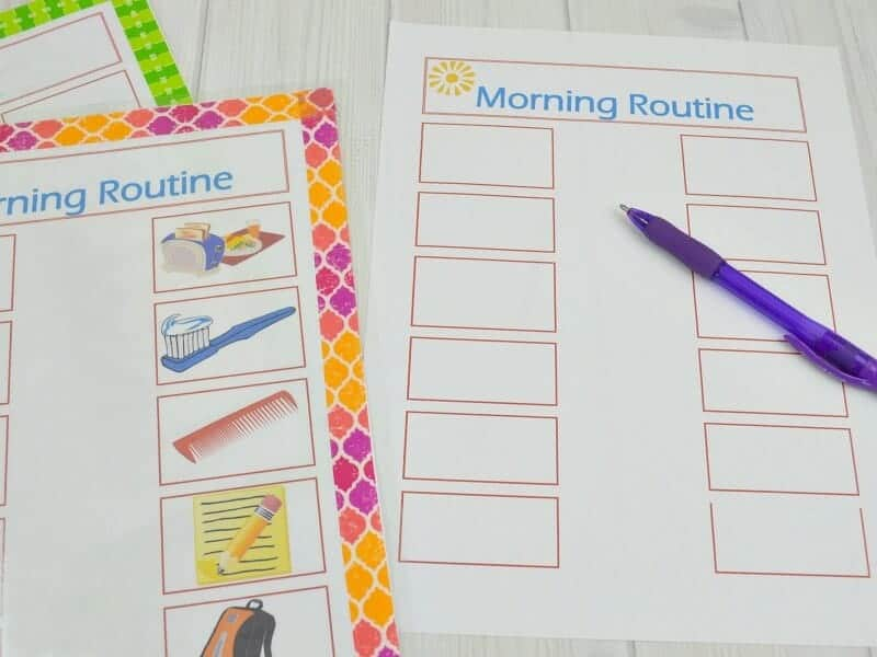 two morning routine print-outs with graphic tape borders, one without and blue pen on it\
