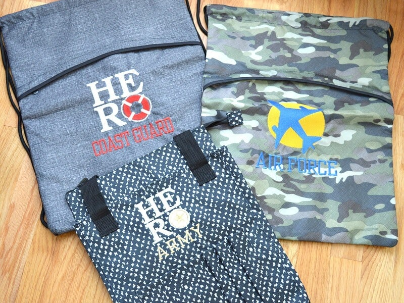 "3 drawstring backpacks with ""hero"" and military logos"