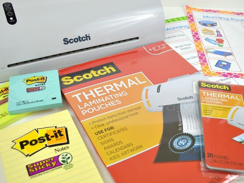 laminating machine with laminating supplies and post it notes, morning routine print-outs