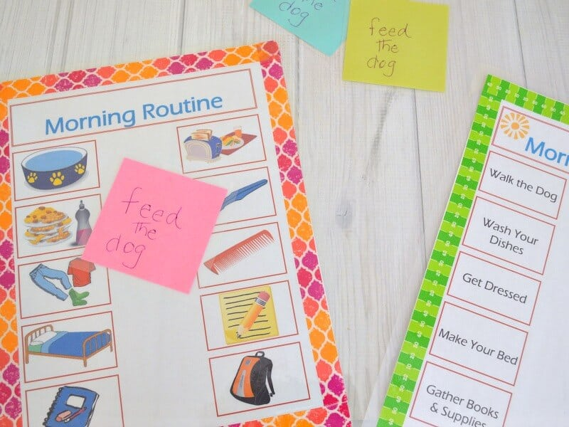 morning routine print-outs with sticky note reminders to feed the dog