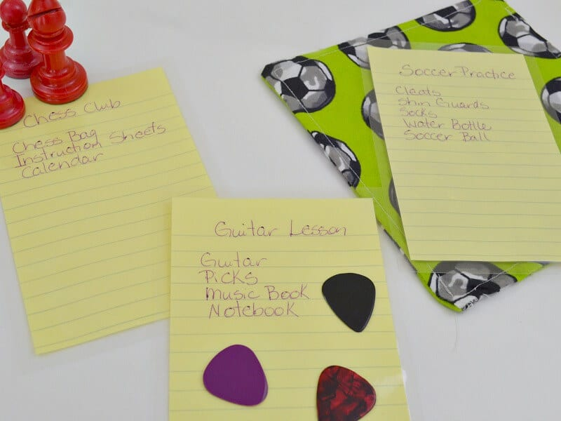 three reminder notes with chess pieces, guitar picks, and soccer graphic