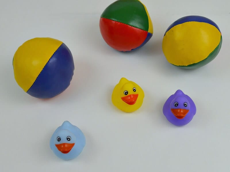 3 colorful balls and 3 mini rubber ducks