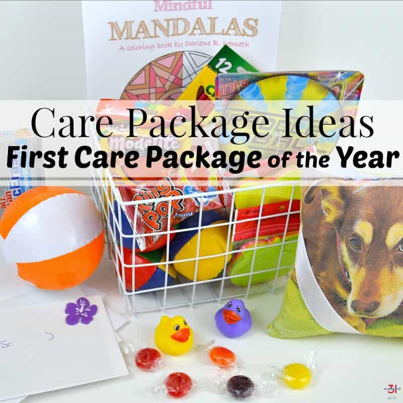 basket with colorful toys and candy on white table with title text overlay reading Care Package Ideas First Care Package of the Year