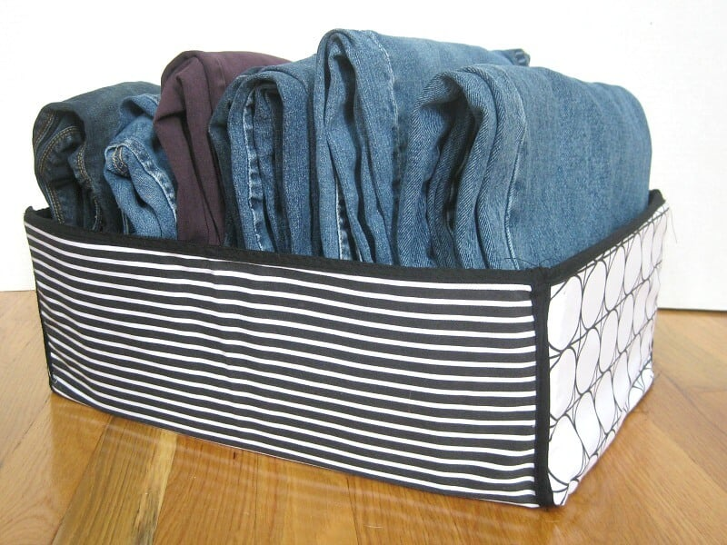 jeans folded neatly in bin