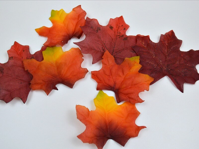 pile of red and orange silk autumn leaves