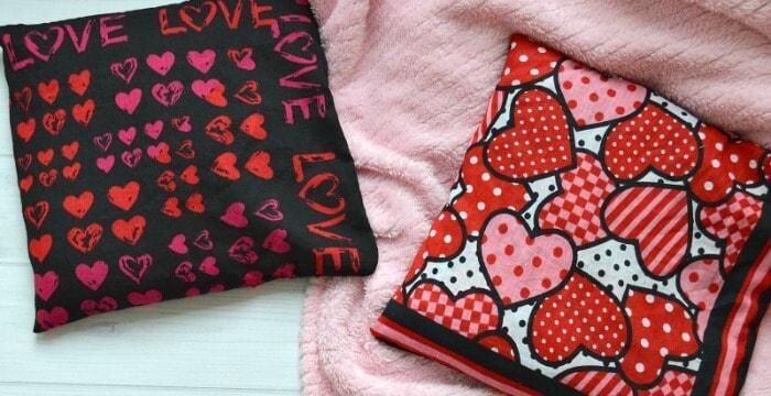 2 rice heat packs on pink blanket