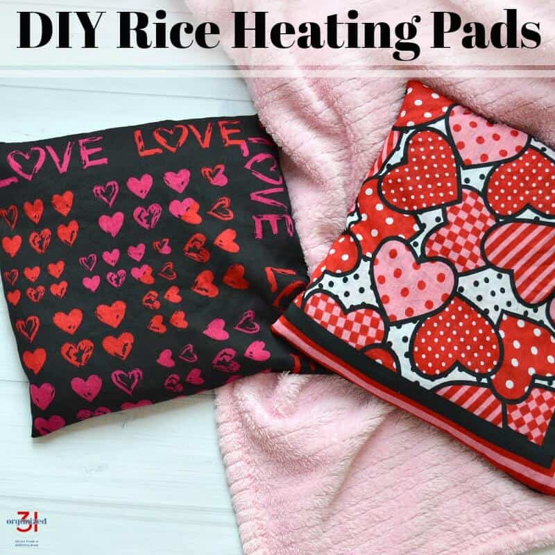 2 heating pads with heart fabric on pink fuzzy blanket with title text reading DIY Rice Heating Pads