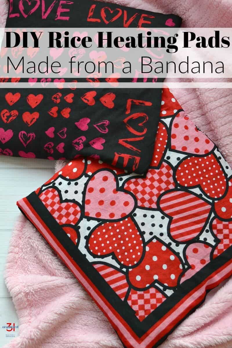 Close up of 2 rice heating pads on pink blanket with title text overlay reading DIY Rice Heating Pads Made from a Bandana