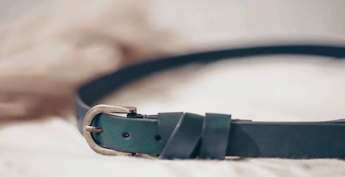 thin black belt on white background