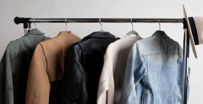 rack of coats on hangers with hat