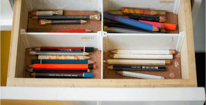 Drawer with dividers and pencils organized