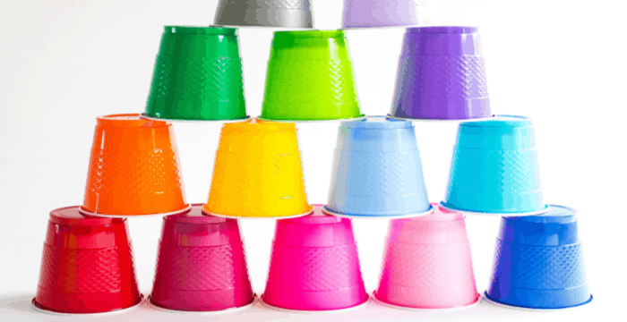 colorful plastic cups stacked in pyramid