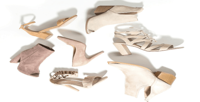 tan shoes scattered on white background